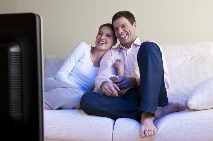Childless couple relaxing in front of the TV